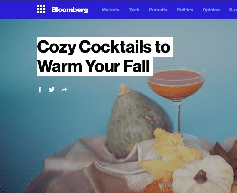 Bloomberg article headline. Text: Cozy Cocktails to Warm Your Fall.