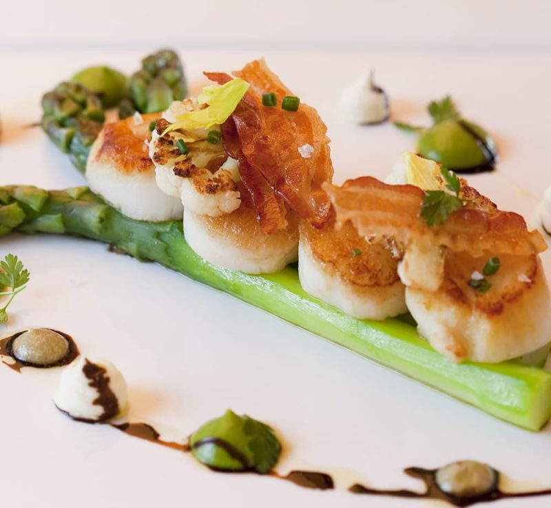 Scallops with bacon and asparagus.