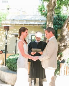 A photo of a couple during their ceremony at one of the best Sonoma wedding venues.