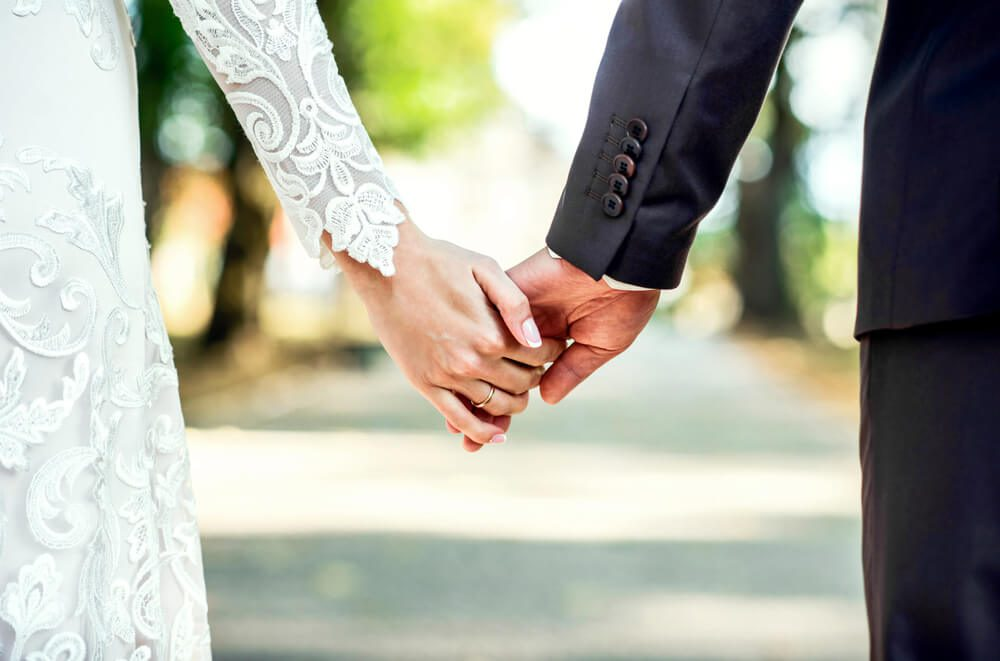 A photo of a couple holding hands at one of the top Sonoma wedding venues.